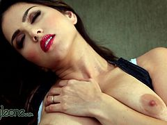 Busty babe likes to feel her warm pussy getting wet during top solo action