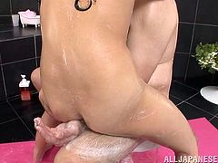 Yuuki Itano has an old Japanese man as a client and she washes his entire body with soap. She rubs her pussy against his leg and then he sits on a clear stool. She sits under the stool and licks his asshole, taint and balls.