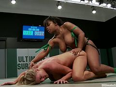 White and Black girls in bikinis fight on a ring. Surely the Black girl winds because she is bigger and stronger. After that the Black girl toys the blonde with a strap-on.