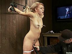 Stunning blonde girl gets bonded. Then a guy fixes metal weights to her nipples. After that she gets her vagina toyed with a vibrator.
