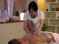 Sizzling Japanese masseuse pleases her client with a great handjob. Then she sits down on his schlong and they have sex in cowgirl and other positions.