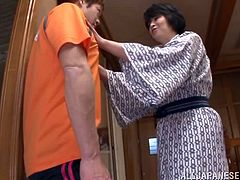 Mature Japanese bitch Chiaki Takeshi is having fun with some guy indoors. She sucks and rubs his dick near the stairs and then they have sex in standing and other positions.