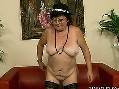 Whorish fat brunette BBW in sheer red lingerie and stockings clings to hard penis of aroused dad to give a skillful blowjob before she rides it reverse cowgirl in sultry sex video by 21 Sextury.