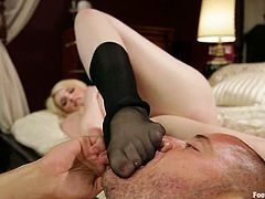 There are footjobs, hardcore sex, female domination, pantyhose action, and more in this video with a busty blonde.