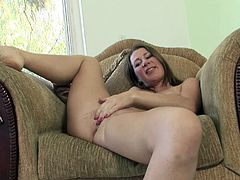 Amateur chick performs a solo scene sticking a dildo in her moist vagina for the camera.