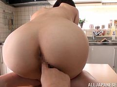 Pretty nude Japanese girl Airi Suzumura is cooking breakfast in the kitchen. Her man comes into the room and makes Airi suck and ride his dick.