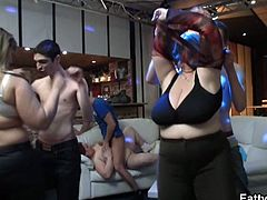 While this plumper brunette gets pounded, there are two more couples watching them. The guys play with their tits.