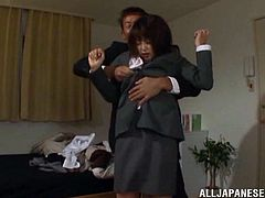 The Japanese girl Saki Ninomiya is wearing her office clothes but that doesn't stop this dude from banging her pussy and fucking her throat.