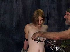 Young redhead obeys older guy in nasty porn session of pure BDSM style