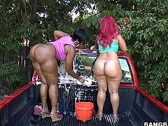Two ebony sluts with huge asses start by washing this dude's car and then they end up having a nasty threesome with him.