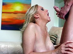 mature blonde takes cock in her mouth