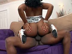 This chocolate temptress sits on her boyfriend's face and lets him get a taste of her fat pussy. Then she takes his meat pole in her juicy snatch and rides it hard in cowgirl position making her ass bounce up and down. After a while horny stud fucks her in standing position.