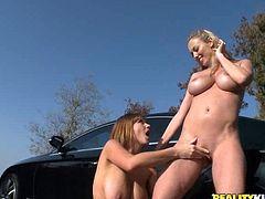 A couple of hot blondes start off washing a car and then they get freaky sucking and fingering each other. Check it out!