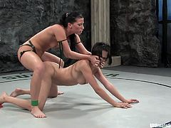 A couple of dirty fucking brunette whores wrestle naked over who fucks who, the winner fucks the loser with a strapon. Check it out!