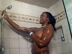 Kinky black chick with droopy big tits goes solo right in the shower. Booty and boobalicious nympho stimulates her pussy with a water jet and groans of delight. This plump appetizing black wanker is surely worth your attention in Pornstar sex clip right here and now.