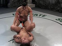 Latin girl loses and fight and gets her pussy licked by DragonLily. After that she gets her tight pussy stuffed with a strap-on.