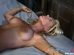 Stacy Burke is the hot blonde with big nipples going through some hot bondage action that also sees her pussy getting fucked hard.