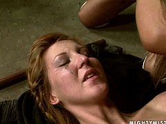 Kinky redhead chick loves being in submission position in BDSM games. So she is tied up on a floor having no chance to make a single move. Her mistress pins her pussy lips bringing her mixed feelings of pain and pleasure.