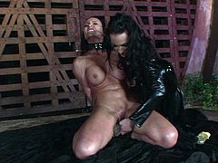 Insatiable tasty looking brunette domina in sexy latex costume fists soaking cunt of busty hoe before pounding it with a dildo in peppering lesbian sex video by 21 Sextury.