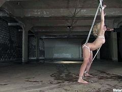 Blonde babe gets tied up in a basement. Then the master puts this hottie in the aquarium and she has to toy her vagina.