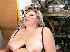 Oversized hot blooded mature BBW sits on the chair with legs wide open while a rapacious daddy drills her soaking cunt with bunch of dildos and stimulates her clit with vibrator.