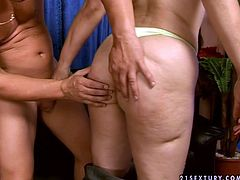 Luscious granny strips before the horny stud. Then, she starts sucking his dick deepthroat. When the guy bends over the couch she licks his ass hole giving him hot rimjob. Kinky grandma in dirty porn video presented by 21 Sextury.