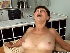 Luscious brunette aunty with shaved pussy is fucking furiously in filthy porn video. She is getting hammered bad in her cunt from behind. She is happy she has finally got fucked brutally.
