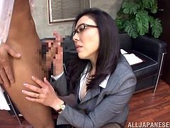 The dorky looking brunette likes taking a short break now and then. When she's not working she relaxes with this guy by sucking his cock. The sensual Japanese milf takes her time in sucking his penis and does a flawless job! She massages his hip with one hand while holding the cock with the other and sucking it.