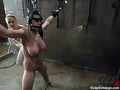 Hot brunette Mallory Knots is having fun with her friend in a basement. She gets bound and immobilized and then enjoys getting her vag toyed and rubbed.