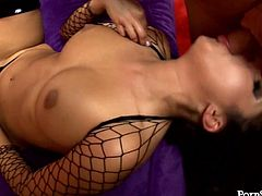 Whorish brunette babe in steamy fishnet bodystocking gives a head to strain dick before titfucking it. Later she clings to suck it zealously and welcome tongue fuck of her tasty punani.