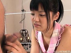 Nasty Japanese chick Kana Aono licks a lollipop and makes her man horny. Then she kneels in front of him and sucks his dick till it explodes with jizz on her face.