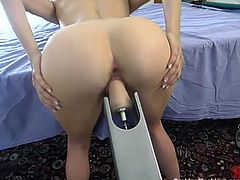 Blonde chick in stockings lies on a bed getting her vagina toyed by the machine. Later on she also rides some big dildo.