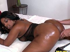 Curvaceous Black girl shakes her oiled up ass in a backyard. Later on she shows her blowjob skill and rides big cock in a bedroom in an interracial sex scene.