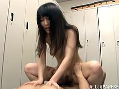 Adorable Japanese chick is having fun with her BF in the locker room. They pet each other and have oral sex and then bang in cowgirl position on a bench.