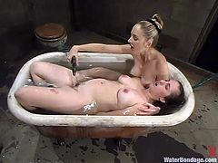 Lewd chubby girl Chloie Madison is getting naughty with her friend in a basement. Chloie lets her friend bind her and then enjoys it when the mistress fucks her snatch with a dildo and drowns her in a bathtub.