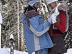 Pigtailed blonde young babe with big knockers Yvone getting slick snatch fucked with a dildo by a lesbian outdoors in the snow