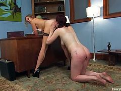 Carmen Stark is getting naughty with hot mistress Maitresse Madeline indoors. Madeline beats Carmen's ass and then fucks it deep and hard with a strap on.