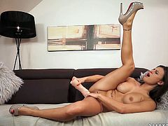 Appealing girlie with knock out body is stretching her poontang with sex toy. Later, another brunette sexpot joins her on set, so the action turns into steamy lesbo fuck.