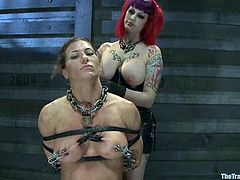 Here are two sizzling and amazing babes that are being abused by a couple. So they get tied up and chained, being forced to do some nasty things with their tongues!