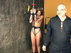 Young redhead receives hard punishment from older guy during BDSM porn scene