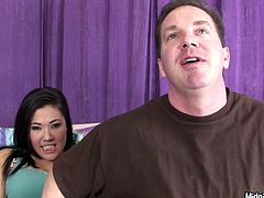 Dark-haired Asian enchantress London Keyes can hypnotize any man with her juicy titties! Moreover, she is a seasoned pro when it comes to pleasing men. She strokes two stiff cock cocks at once to make them hard and ready. Then she gets down on her knees and gives one of the guys a nice blowjob.