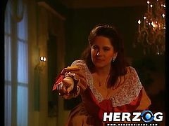 Cute Heidi is wearing a Baroque dress. She has her pussy slammed on a bed, followed by a face fucking session from under the bed.