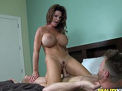 Well stacked milf hops on cock face to face and her massive impressive fake tits bounce like crazy balls. Later she licks balls and gives blowjob.