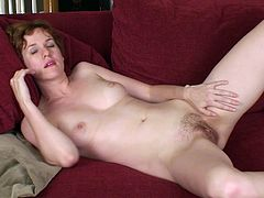Get a load of this hottie's hairy bush in this solo video where she masturbates with a dildo that makes her hit some high notes.