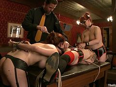 Iona Grace, Nerine Mechanique and one more girl are getting naughty in the living room. They let a dominatrix tie them up and then lick each other's nice nipples.