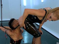 Hot bossy blonde Lea has her obedient sex slave Nikki tied up and ready for something shocking. The black whore needs to learn her place and for that Lea begins by putting her to lick her sexy white ass. A few licks in her pussy and now Lea begins to electrocute her.