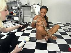 This petite and sexy honey Kelana spreads her legs, being bondaged, and gives her exotic twat to that crazy blond mistress. Girl is fucked up!