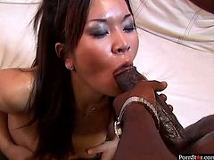 Obedient oriental slut stands on her knees and sucks huge erected black cock. Later BBC fills her mouth hole with cum delicacy and she enjoys it.