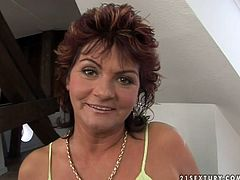 Lusty mature mom has got big saggy boobs. She takes off her clothes exposing her tits. Then she sits on a couch pumping hard stick of young man with her mouth lips. This woman is experienced one.