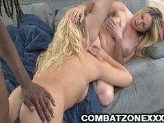See the vicious and busty blonde belles Angela Attison and Britney Young taking turns sucking a thick rod of black meat. Then see them riding it into ecstasy with their superbly tight clams.